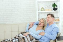 Couple at home on the couch talking and smiling. Closeup stock images