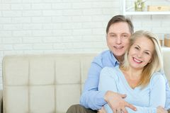 Couple at home on the couch talking and smiling. Closeup stock photos