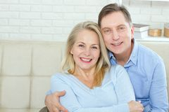 Couple at home on the couch talking and smiling. Closeup stock photography