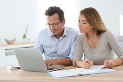 Couple at home doing tax declaration on internet Stock Photo