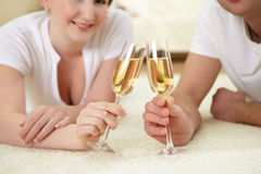 Couple at home drinking champagne Stock Photo