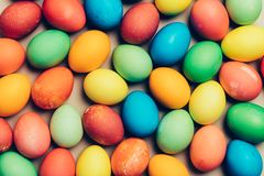 Couple of home-dyed eggs laying on the ground. Christian holiday. Easter Stock Images