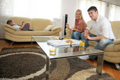 Couple at home eating  pizza Stock Photo