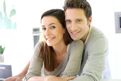 Couple at home embracing each other stock photos