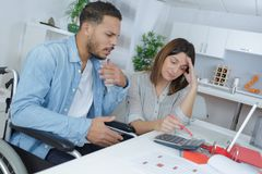 Couple at home grinding out numbers. Couple at home grinding out some numbers Stock Photos