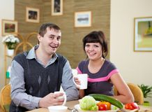 Couple at home having meal Stock Photos