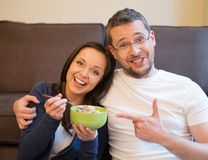 Couple in home interior with food Royalty Free Stock Photo