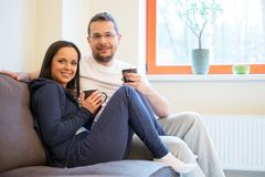 Couple in home interior Stock Images