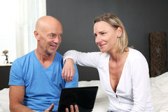 Couple at home on laptop Stock Photo