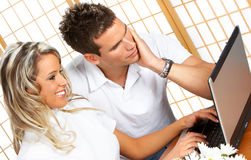 Couple at home with laptop Royalty Free Stock Image
