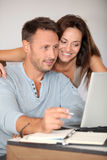 Couple at home with laptop computer Royalty Free Stock Photo
