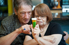 Couple at Home with Medication Royalty Free Stock Photography