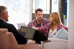 Couple At Home Meeting With Financial Advisor Stock Image