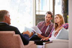 Couple At Home Meeting With Financial Advisor royalty free stock images