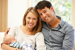 Couple at home with new baby Stock Images