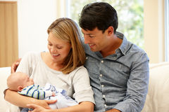 Couple at home with new baby Stock Image