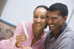 Couple with home pregnancy test. Couple with positive home pregnancy test stock image