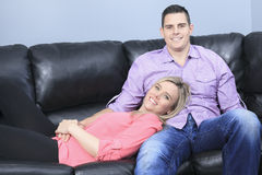 Couple at home relaxing in sofa. A Couple at home relaxing in sofa stock images