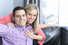 Couple at home relaxing in sofa. A Couple at home relaxing in sofa royalty free stock images