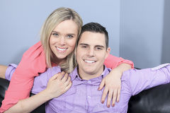 Couple at home relaxing in sofa. A Couple at home relaxing in sofa royalty free stock photo
