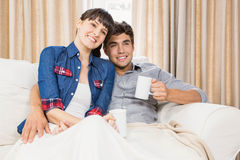 Couple at home relaxing on the sofa. Romantic couple at home relaxing on the sofa having coffee stock photos