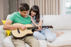 Couple at home relaxing on the sofa Stock Photography