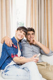 Couple at home relaxing on the sofa. Romantic couple at home relaxing on the sofa watching television royalty free stock photos