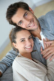 Couple at home relaxing on sofa. Upper view of couple at home relaxing in sofa royalty free stock photos