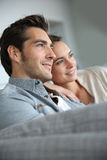 Couple at home relaxing watching tv Stock Photography