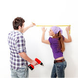Couple and home repairs Royalty Free Stock Image
