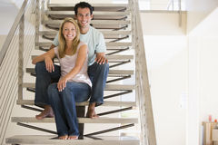 Couple at home sitting on stairs Stock Photo