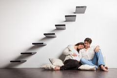 Couple at home sitting on stairs. Pregnancy Stock Photography