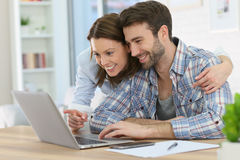 Couple at home surfing in internet using a laptop Royalty Free Stock Images