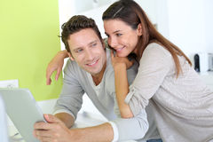 Couple at home with tablet Stock Photos