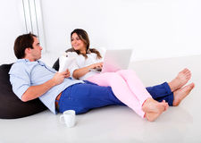 Couple at home talking Royalty Free Stock Photos