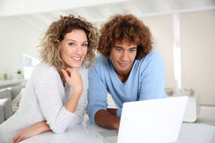 Couple at home using laptop. Couple websurfing on laptop computer Stock Image