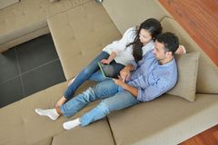 Couple at home using tablet computer Royalty Free Stock Photography