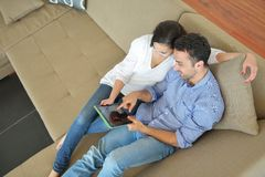 Couple at home using tablet computer Royalty Free Stock Image