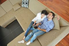 Couple at home using tablet computer Stock Photography