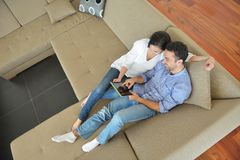 Couple at home using tablet computer Stock Image