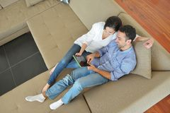 Couple at home using tablet computer Stock Photo
