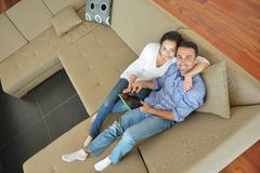 Couple at home using tablet computer Royalty Free Stock Images