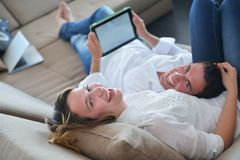 Couple at home using tablet computer Stock Photos