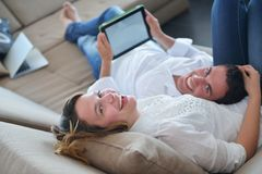Couple at home using tablet computer Stock Images