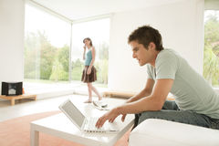 Couple at Home Using Technology Stock Image