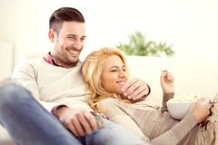 Couple at home watching TV Royalty Free Stock Photo