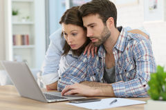 Couple at home websurfing Stock Images