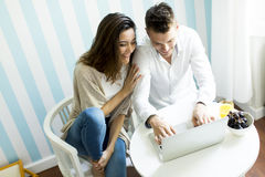 Couple at home websurfing Royalty Free Stock Photography