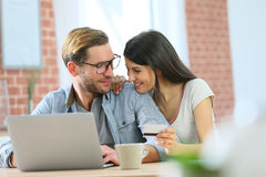 Couple at home websurfing on laptop Stock Images