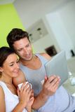 Couple at home websurfing with tablet Stock Photo